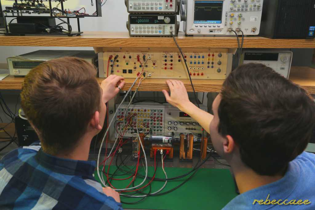 Students working in a control systems lab